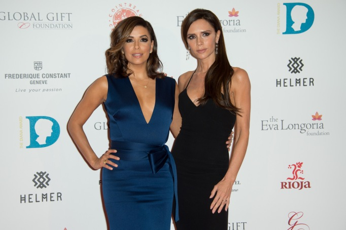 Eva Longoria and Victoria Beckham pose for photographers upon arrival at the Global Gift Gala 2015 in London Britain Global Gift Gala 2015, London, United Kingdom