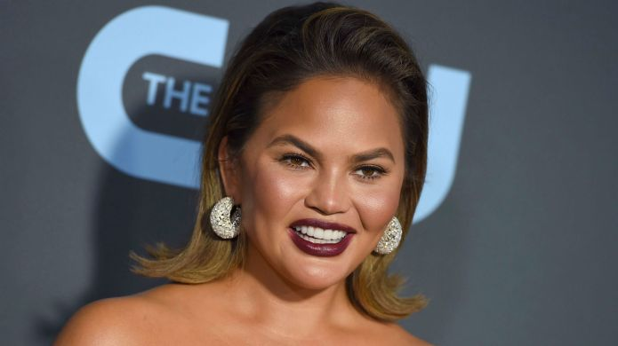 Chrissy Teigen Says She Chipped a Tooth While Filming Family Feud – SheKnows