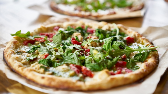 authentic gourmet pizza with fresh arugula,