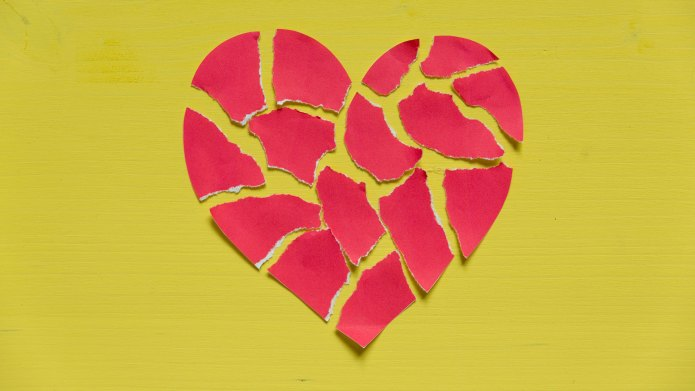 Broken heart made of shredded paper