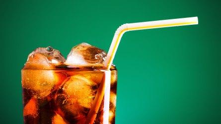 Glass of soda with a straw.