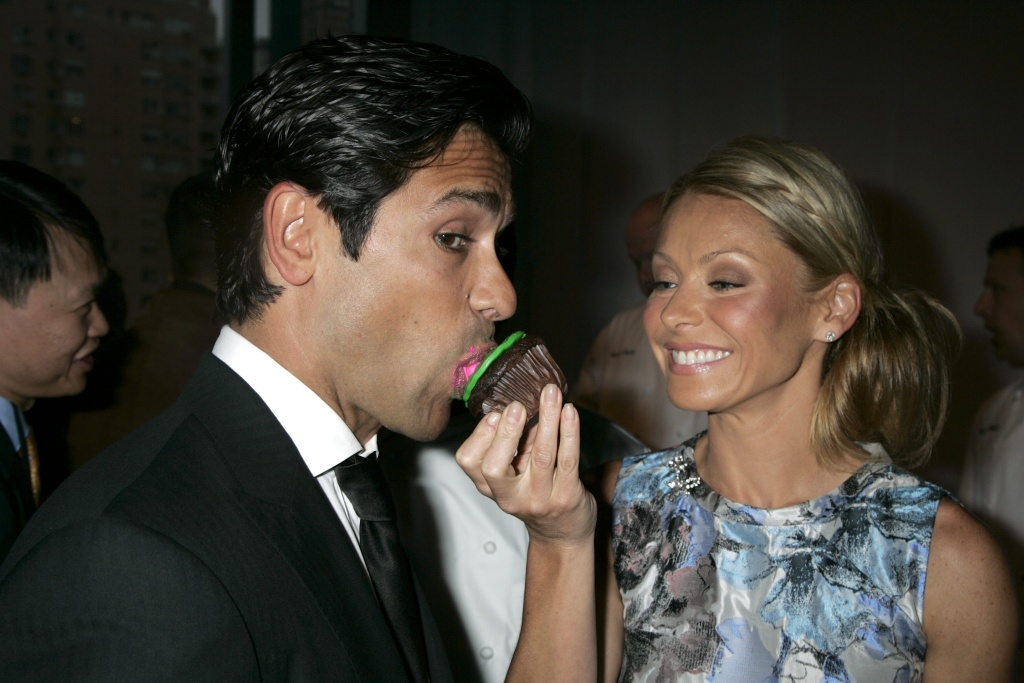 Mark Consuelos and Kelly RipaDiscovery Communications 2009 Upfront in New York, America - 02 Apr 2009Discovery Communications rolled out new shows for the Oprah Winfrey Network, TLC, Animal Planet and Science channel at its upfront presentation of programming for advertisers. One series, 'Eat, Drink and Be Married' comes from Kelly Ripa and Mark Consuelos' Milojo Productions and focuses on the Frungillo family, who operate a successful catering facility.