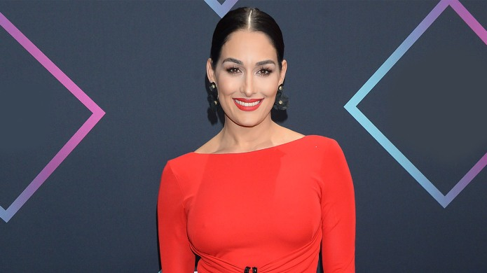 Nikki Bella alone in red dress.