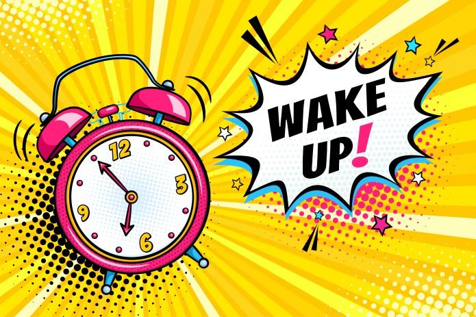 A bright cartoon alarm clock in