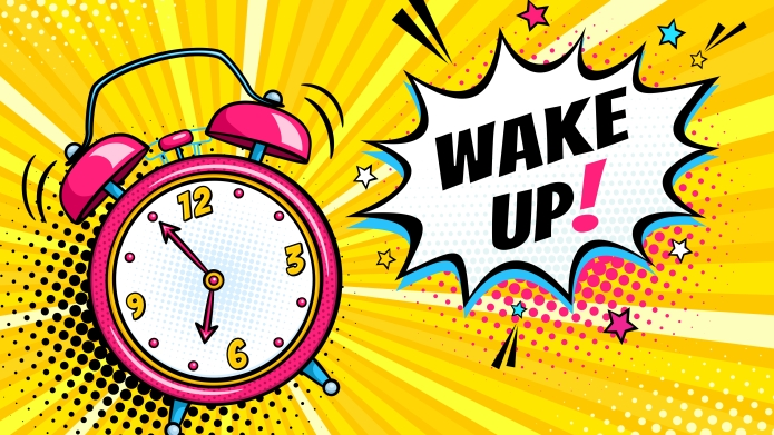 A bright cartoon alarm clock in