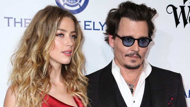 Amber Heard and Johnny Depp attend The Art of Elysium's Ninth Annual Heaven Gala