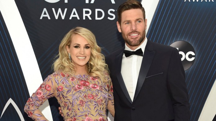 Carrie Underwood and Mike Fisher attend