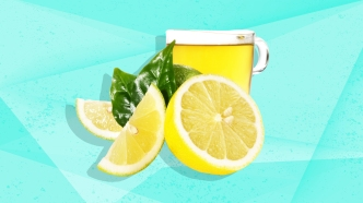 Lemons, tea and leaves on blue