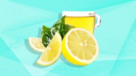 Lemons, tea and leaves on blue