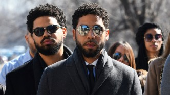 Jussie Smollett, center, arrives at Leighton