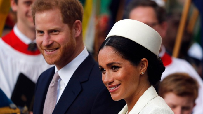 Meghan Markle and Prince Harry leave