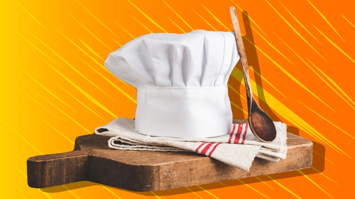 Chef's hat, antique cutting board and