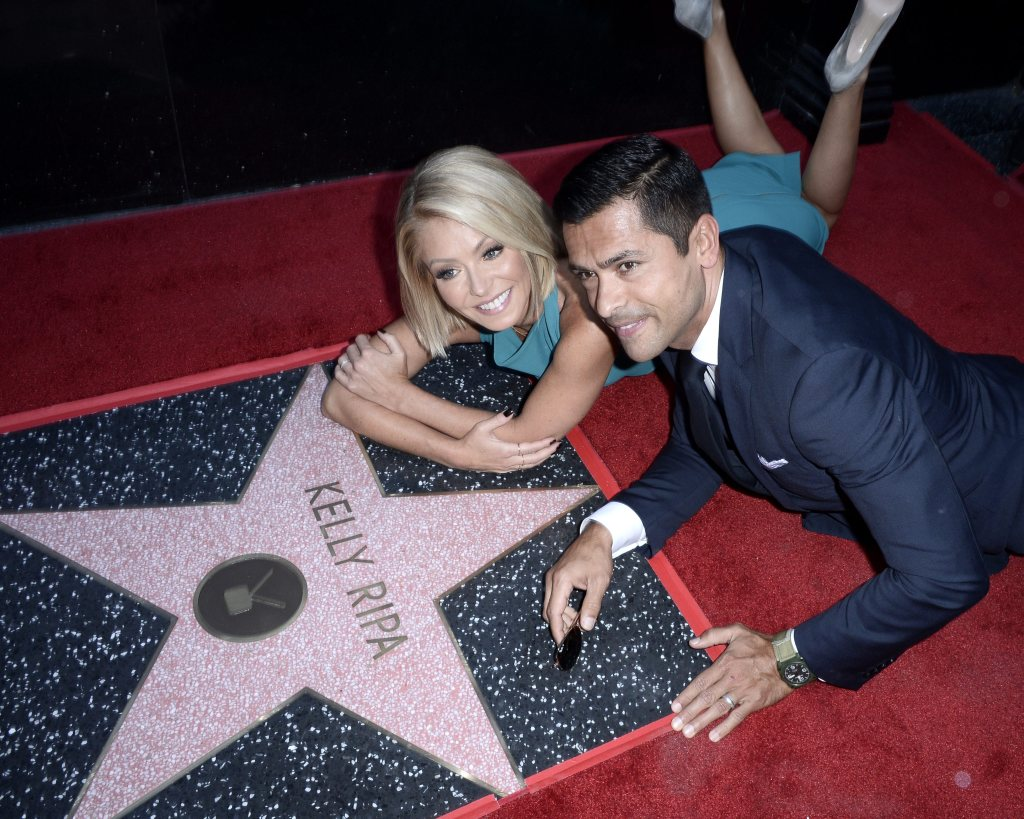 Kelly Ripa and Husband Mark Consuelos (r) Pose with Ripa's Star on the Hollywood Walk of Fame During Ceremony in Hollywood California Usa 12 October 2015 Ripa Received the 2561st Star on the Walk of Fame in the Category of Television United States HollywoodUsa Hollywood Walk of Fame - Oct 2015