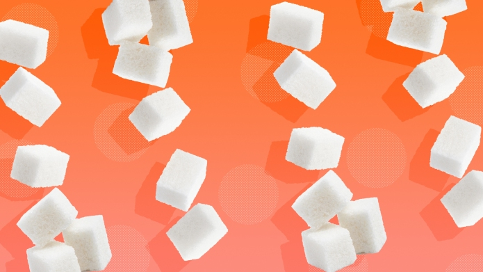 Sugar cubes on orange background