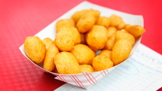 Golden fried cheese curds. Shallow focus.;