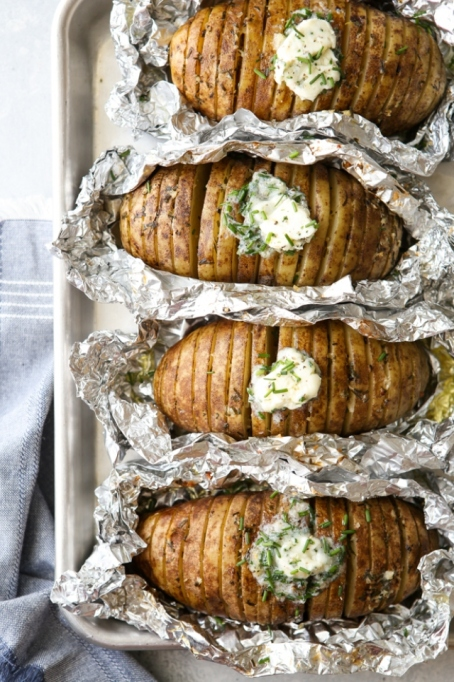 Grilled Hasselback Potatoes with Chive Butter.