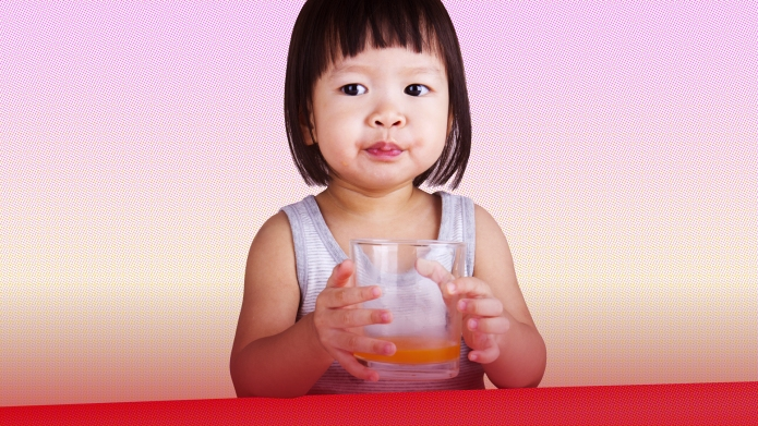 Image of young girl drinking juice