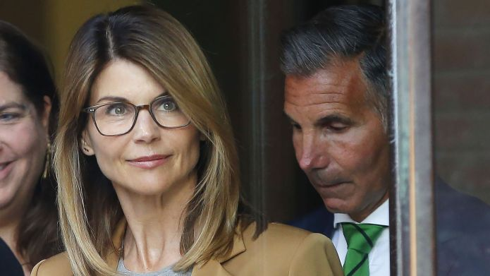 Lori Loughlin (L) and husband Mossimo