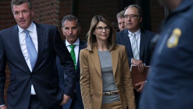 Lori Loughlin (C) and her husband Mossimo Giannulli (2nd L) leave the John J Moakley Federal Court House