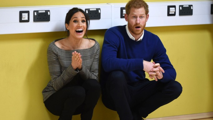 Prince Harry and Meghan Markle at a street dance class during their visit to Star Hub