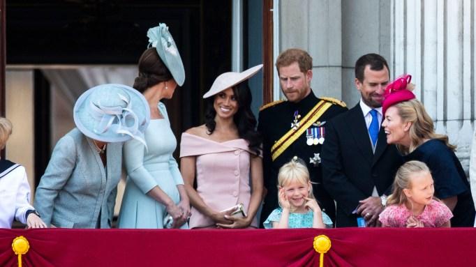 meghan markle, kate middleton, and prince harry at buckinham palace balcony