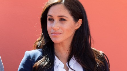 Meghan Markle in front of orange
