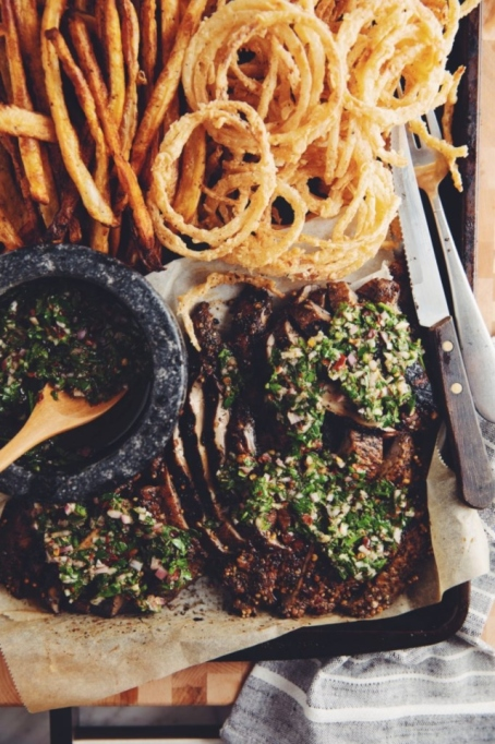 Grilled Portobello Steaks with Chimichurri and Onion Strings.