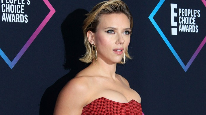 Scarlett Johansson poses in the press