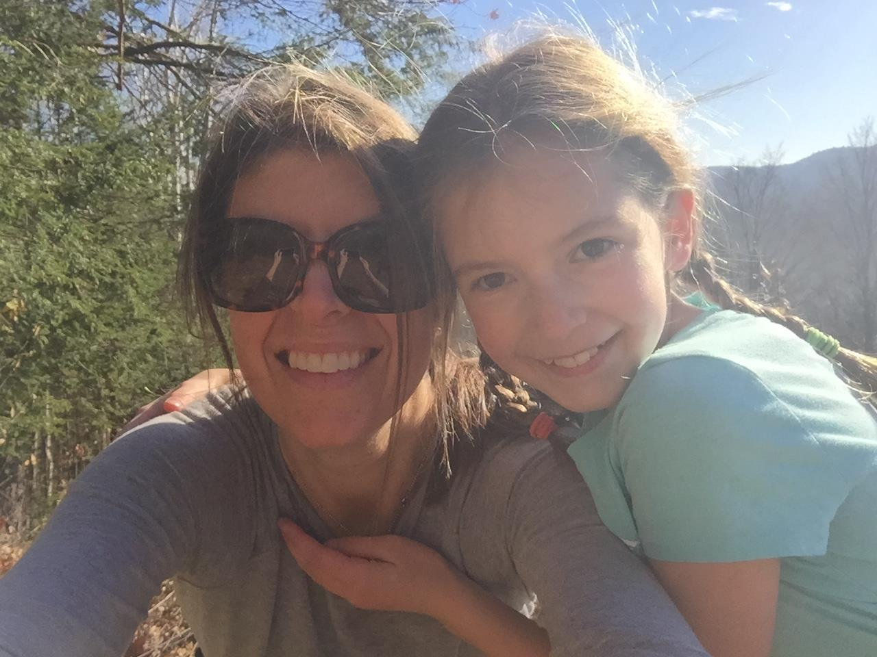 mom and daughter in the woods