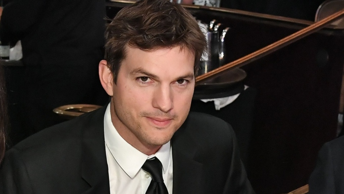Ashton kutcher in a suit
