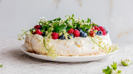 decorated cream pie with branches of