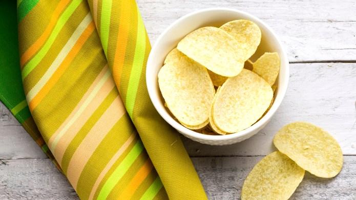 potato chips on white glass bowl