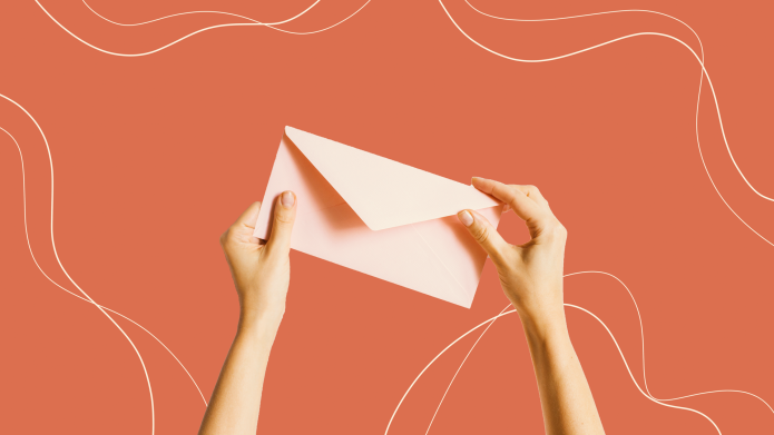 woman writing letter envelope
