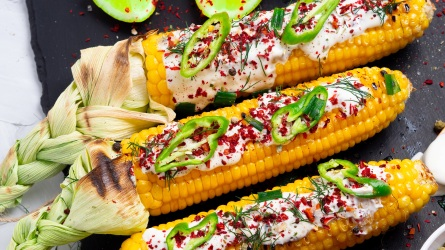 Grilled corn with cream sauce, spices,