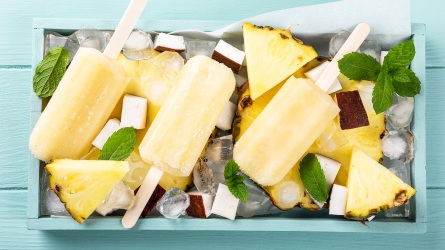 Delicious homemade pineapple coconut popsicles on