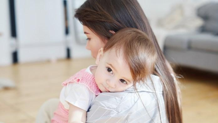 Crying baby girl with big brown