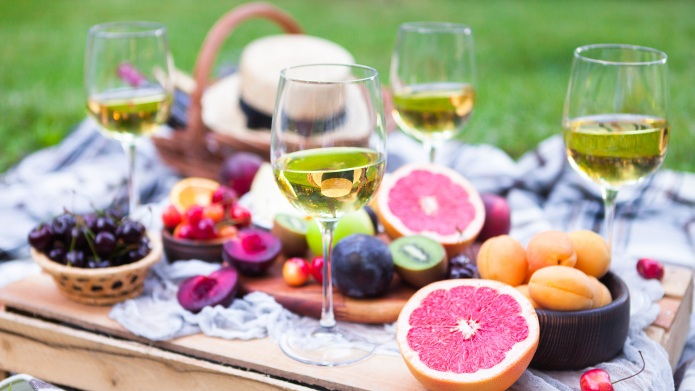 Picnic background with white wine and