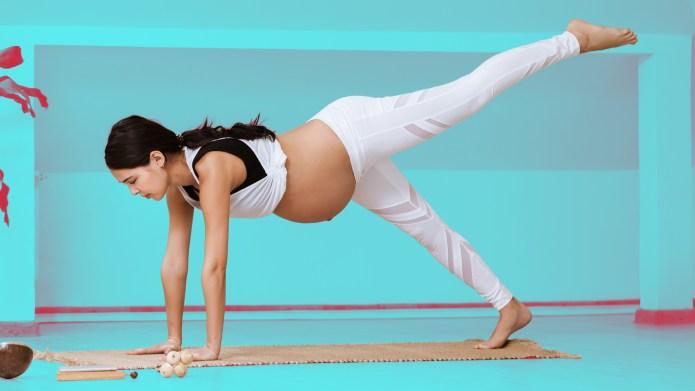 Pregnant woman doing yoga