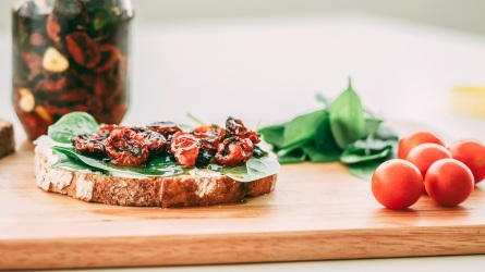 Sun-dreied tomatoes on a toast; Shutterstock