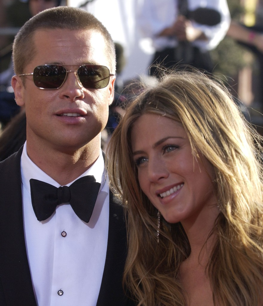 """Jennifer Aniston, right, and husband Brad Pitt pose for photographers on as they arrive for the 56th Annual Primetime Emmy Awards, at the Shrine Auditorium in Los Angeles. Aniston is nominated for outstanding lead actress in a comedy series for her work on """"Friends EMMYS, LOS ANGELES, USA"""