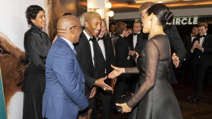 Meghan Markle meeting Pharrell.