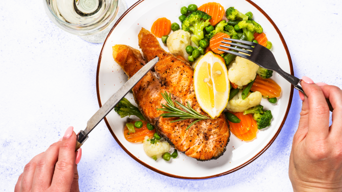 A plate with salmon and vegetables