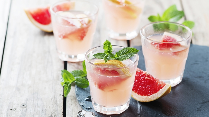 Pink cocktail with ice and mint,