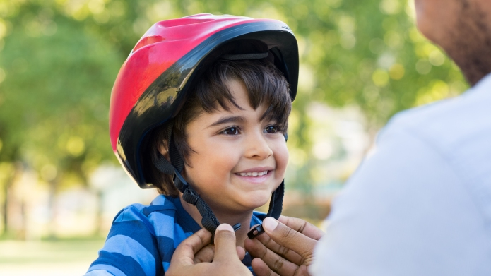 young boy wearing bicycle helmet