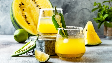 Spicy golden watermelon margarita cocktail with