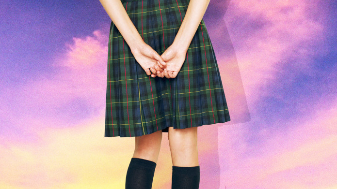 Girl in knee-high plaid skirt