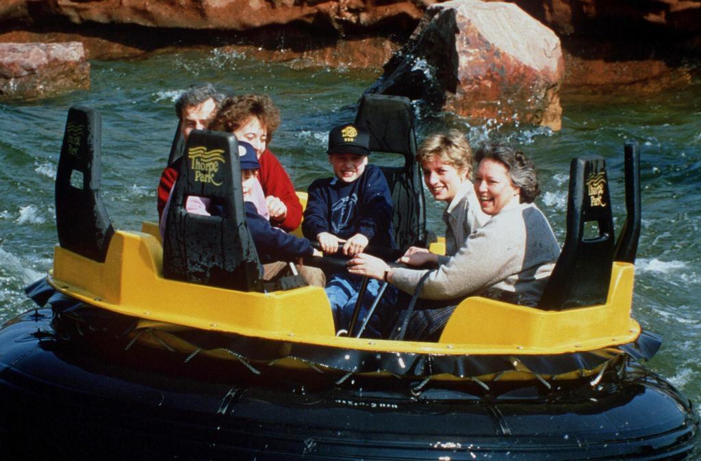 PRINCES WILLIAM AND HARRY WITH PRINCESS DIANA AND NANNY JESSICA WEBB ON A FAIR RIDE - 1991PRINCE HARRY AND PRINCE WILLIAM IN THUNDER RIVER RIDE BOAT AT THORPE PARK 1991