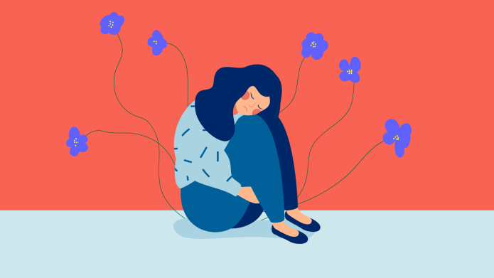 Sad woman with flowers