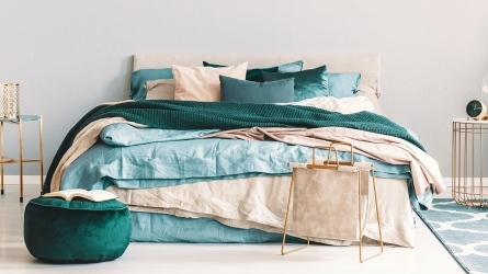 Blue, beige and emerald green bedding