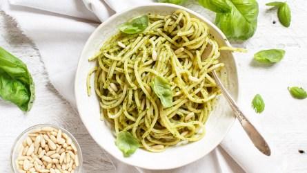 Spaghetti pasta with pesto sauce, basil,